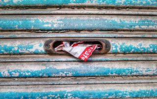 Mail shoved into a door slot - Photo by Franck V. on Unsplash